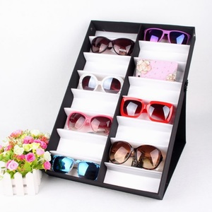 Sunglasses folding holder display with 16 slots, black with a white lining