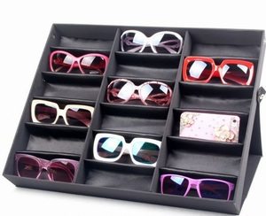 Sunglasses folding holder display with 18 slots, black with a black lining