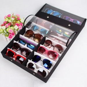 Sunglasses holder display with 16 slots, black with a white lining
