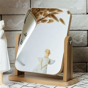 Rotating table mirror for optics salon with brown tint, 25*19 cm